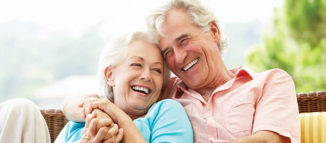 Elderly couple laughing together
