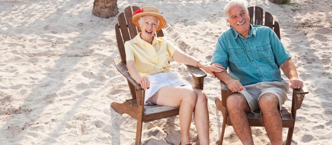 Elderly couple sitting outside